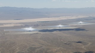 CAP_006_032 - HD stock footage aerial video of the power towers and mirror arrays of the Ivanpah Solar Electric Generating System in California