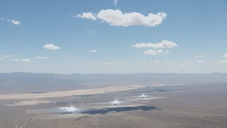 CAP_006_033 - HD stock footage aerial video of clouds hovering above the Ivanpah Solar Electric Generating System in California