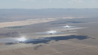 CAP_006_034 - HD stock footage aerial video of cloud shadows on the Ivanpah Solar Electric Generating System in California