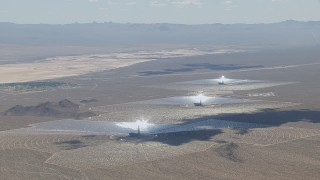 CAP_006_036 - HD stock footage aerial video of a view of the Ivanpah Solar Electric Generating System in California with cloud shadow on the arrays