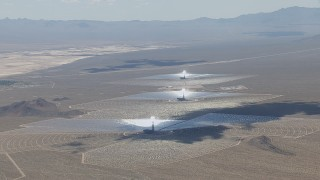 CAP_006_037 - HD stock footage aerial video of a view of the Ivanpah Solar Electric Generating System in California with cloud shadow across the arrays