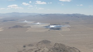 CAP_006_040 - HD stock footage aerial video of a view across the desert at the Ivanpah Solar Electric Generating System in California