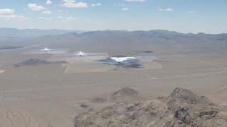 CAP_006_041 - HD stock footage aerial video of a view across the open desert at the Ivanpah Solar Electric Generating System in California
