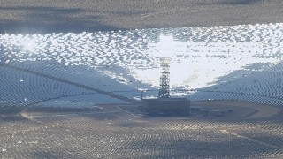 CAP_006_042 - HD stock footage aerial video of cloud shadow on mirrors at Ivanpah Solar Electric Generating System in California
