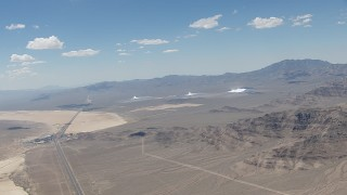 CAP_006_048 - HD stock footage aerial video of a view of the three solar arrays at Ivanpah Solar Electric Generating System in California next to I-15