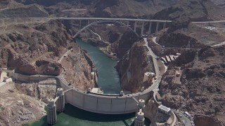 CAP_008_002 - HD stock footage aerial video orbit Hoover Dam and the bypass bridge, Nevada