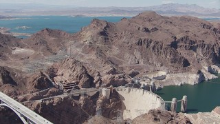 CAP_008_003 - HD stock footage aerial video orbit Hoover Dam, with Lake Mead visible in the background, Nevada