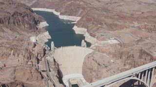 CAP_008_004 - HD stock footage aerial video orbit Hoover Dam and the Colorado River, Nevada