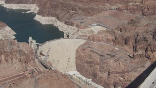 CAP_008_005 - HD stock footage aerial video orbit Hoover Dam as cars cross the top of the structure, Nevada