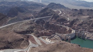 CAP_008_009 - HD stock footage aerial video of a wide view of the Kingman Wash Access Road, Hoover Dam, and the bypass bridge, Nevada