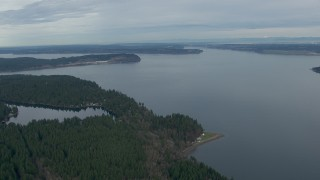 CAP_009_002 - HD stock footage aerial video fly over Anderson Island to approach Puget Sound, Washington