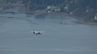 CAP_009_011 - HD stock footage aerial video track an airplane flying over Puget Sound, and reveal waterfront homes, Washington