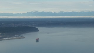 CAP_009_019 - HD stock footage aerial video of a cargo ship sailing Puget Sound and the Olympic Mountains, Washington