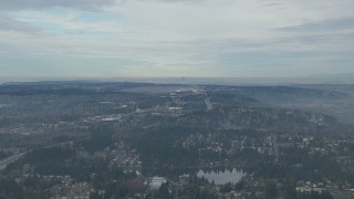 CAP_009_029 - HD stock footage aerial video of Seattle Tacoma Airport and the Downtown Seattle skyline seen from I-5 and suburban neighborhoods, Washington