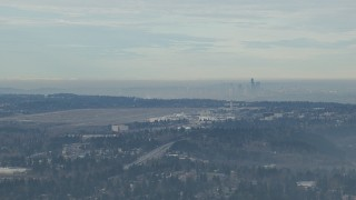 CAP_009_030 - HD stock footage aerial video of Seattle Tacoma Airport and the Downtown Seattle skyline seen from south of the city, Washington