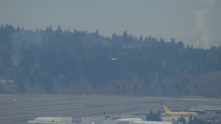 CAP_009_031 - HD stock footage aerial video track a plane coming in for a landing at Seattle Tacoma Airport, Washington