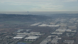 CAP_009_032 - HD stock footage aerial video of the Downtown Seattle skyline seen from warehouse buildings in Kent, Washington