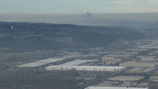 CAP_009_033 - HD stock footage aerial video of the Downtown Seattle city skyline seen from warehouse buildings in Kent, Washington