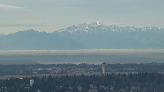 CAP_009_035 - HD stock footage aerial video of the Olympic Mountains and the Seattle Tacoma Airport control tower, Washington