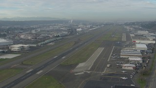 CAP_009_041 - HD stock footage aerial video fly over hangars and parked planes at Boeing Field, Washington