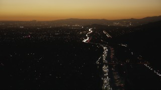 CAP_010_005 - HD stock footage aerial video follow heavy traffic on the I-10 freeway at sunset through the in the San Gabriel Valley, California