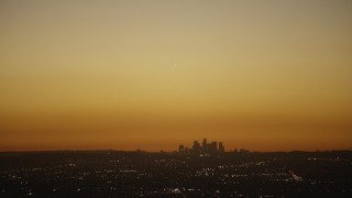 CAP_010_007 - HD stock footage aerial video bright light over the Downtown Los Angeles city skyline at twilight, California