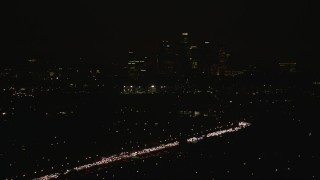 CAP_010_010 - HD stock footage aerial video approach the Downtown Los Angeles city skyline at night, California