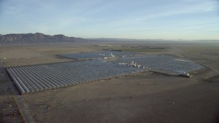 CAP_011_004 - HD stock footage aerial video of a PG&E power plant in Daggett, California at sunrise