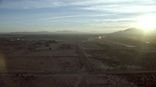 CAP_011_005 - HD stock footage aerial video approach the Barstow-Daggett Airport in California at sunrise