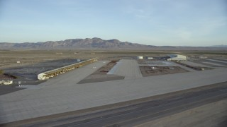 CAP_011_007 - HD stock footage aerial video pan across hangars at the Barstow-Daggett Airport in California at sunrise