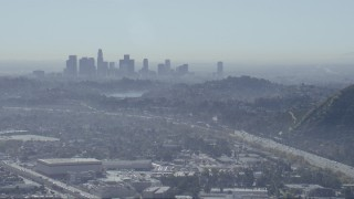 CAP_012_006 - HD stock footage aerial video of a view of the Downtown Los Angeles skyline, Silver Lake Reservoir, and I-5 freeway, California