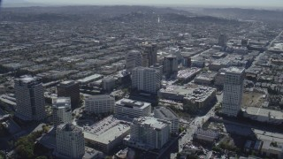 CAP_012_008 - HD stock footage aerial video of tall office buildings beside the 134 freeway in Glendale, California