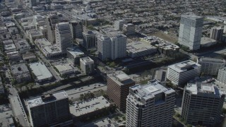CAP_012_009 - HD stock footage aerial video flyby tall office buildings beside the 134 freeway in Glendale, California