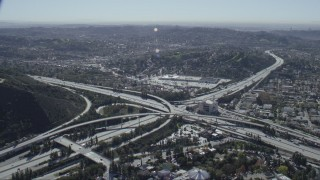 CAP_012_010 - HD stock footage aerial video of the 2 and 134 freeway interchange in Glendale, California