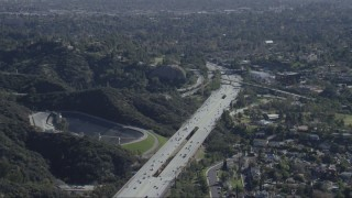 CAP_012_012 - HD stock footage aerial video fly over the 134 freeway and Eagle Rock Reservoir in Eagle Rock, California