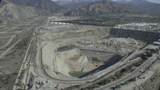 CAP_012_018 - HD stock footage aerial video of passing a quarry in Asuza, California