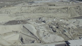 CAP_012_019 - HD stock footage aerial video flyby a working quarry in Asuza, California