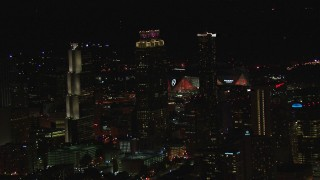 CAP_013_005 - HD stock footage aerial video of Mercedes Benz Stadium while flying by skyscrapers at night, Downtown Atlanta, Georgia