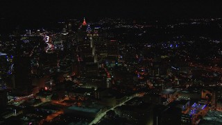 CAP_013_010 - HD stock footage aerial video of circling skyscrapers and city buildings at night, Downtown and Midtown Atlanta, Georgia