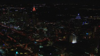 CAP_013_012 - HD stock footage aerial video of flying by tall skyscrapers at night, Downtown and Midtown Atlanta, Georgia