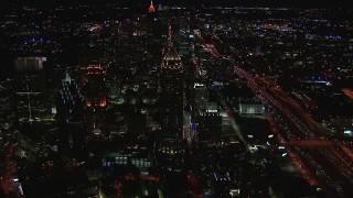 CAP_013_018 - HD stock footage aerial video flying away from One Atlantic Center at night, Midtown Atlanta, Georgia