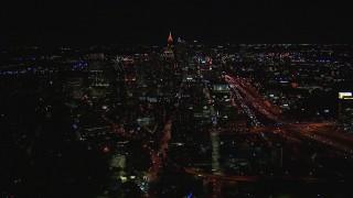 CAP_013_020 - HD stock footage aerial video wide reverse view of city buildings and skyscrapers at night, Midtown Atlanta, Georgia