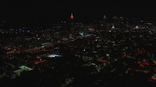 CAP_013_023 - HD stock footage aerial video of flying past city buildings and skyscrapers at night, Midtown and Downtown Atlanta, Georgia