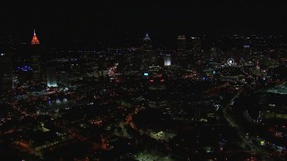 CAP_013_024 - HD stock footage aerial video of flying past city buildings and skyscrapers at night, Downtown Atlanta, Georgia