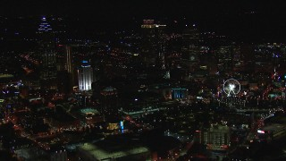 CAP_013_025 - HD stock footage aerial video of passing city buildings and skyscrapers at night, Downtown Atlanta, Georgia