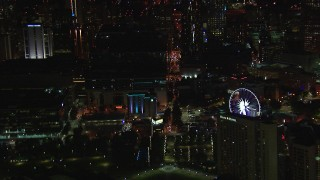 CAP_013_026 - HD stock footage aerial video of flying by city buildings and Ferris wheel at night, Downtown Atlanta, Georgia