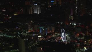 CAP_013_027 - HD stock footage aerial video of orbiting city buildings and Ferris wheel at night, Downtown Atlanta, Georgia