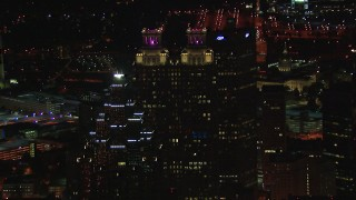 CAP_013_034 - HD stock footage aerial video fly away from 191 Peachtree Tower, reveal SunTrust Plaza at night, Downtown Atlanta, Georgia