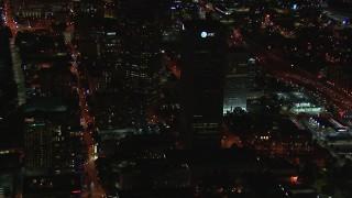 CAP_013_038 - HD stock footage aerial video of AT&T Center skyscraper at night, Midtown Atlanta, Georgia