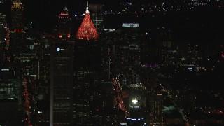 CAP_013_042 - HD stock footage aerial video reverse view of Bank of America Plaza at night, Midtown Atlanta, Georgia